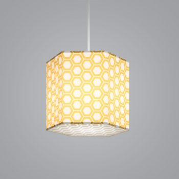 Lumetta's custom HexagonLite Pendant is shown with a yellow honeycomb Lumenate® diffuser and a etched honeycomb white acrylic bottom lens.