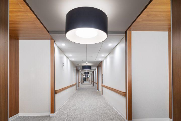 Cambridge Manor chose L2 Drum Pendant luminaries for their space.